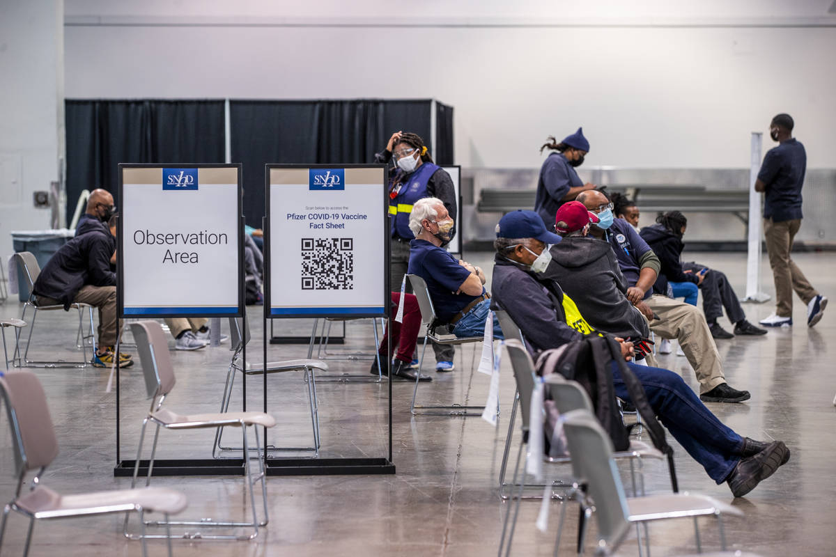 L.E. Baskow/Las Vegas Review-Journal People sit in the observation area after receiving the Mod ...