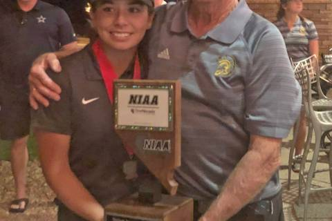 File photo Then-junior Breanne Nygaard and PVHS golf coach Bob Hopkins pose with the trophy aft ...