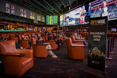 L.E. Baskow/Special to the Pahrump Valley Times People watch events as the Westgate sportsbook ...