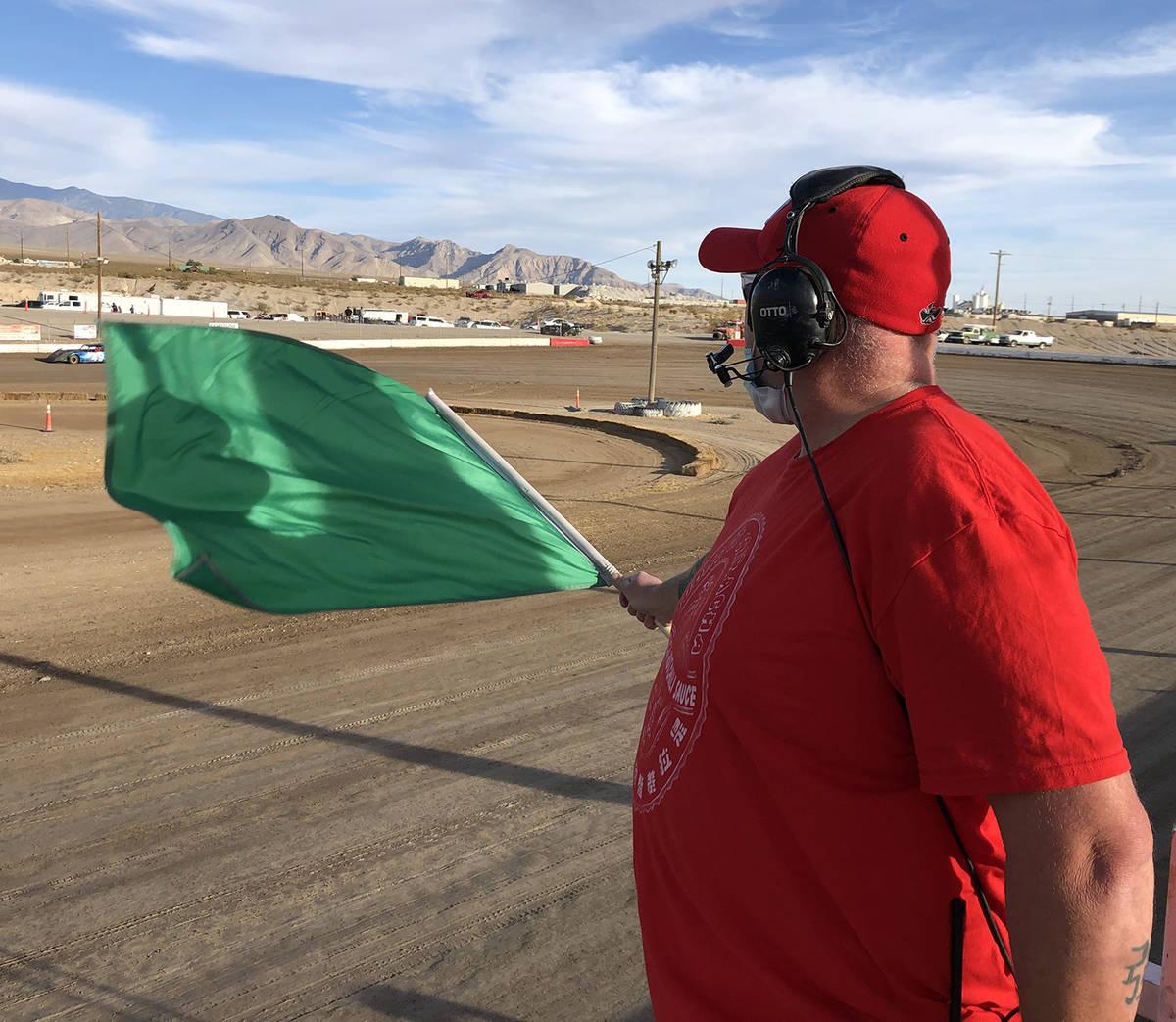 Tom Rysinski/Pahrump Valley Times Flagman Dale Geissler uses the green flag to signal the start ...