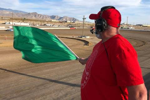 Tom Rysinski/Pahrump Valley Times Flagman Dale Geissler uses the green flag to signal the start ...