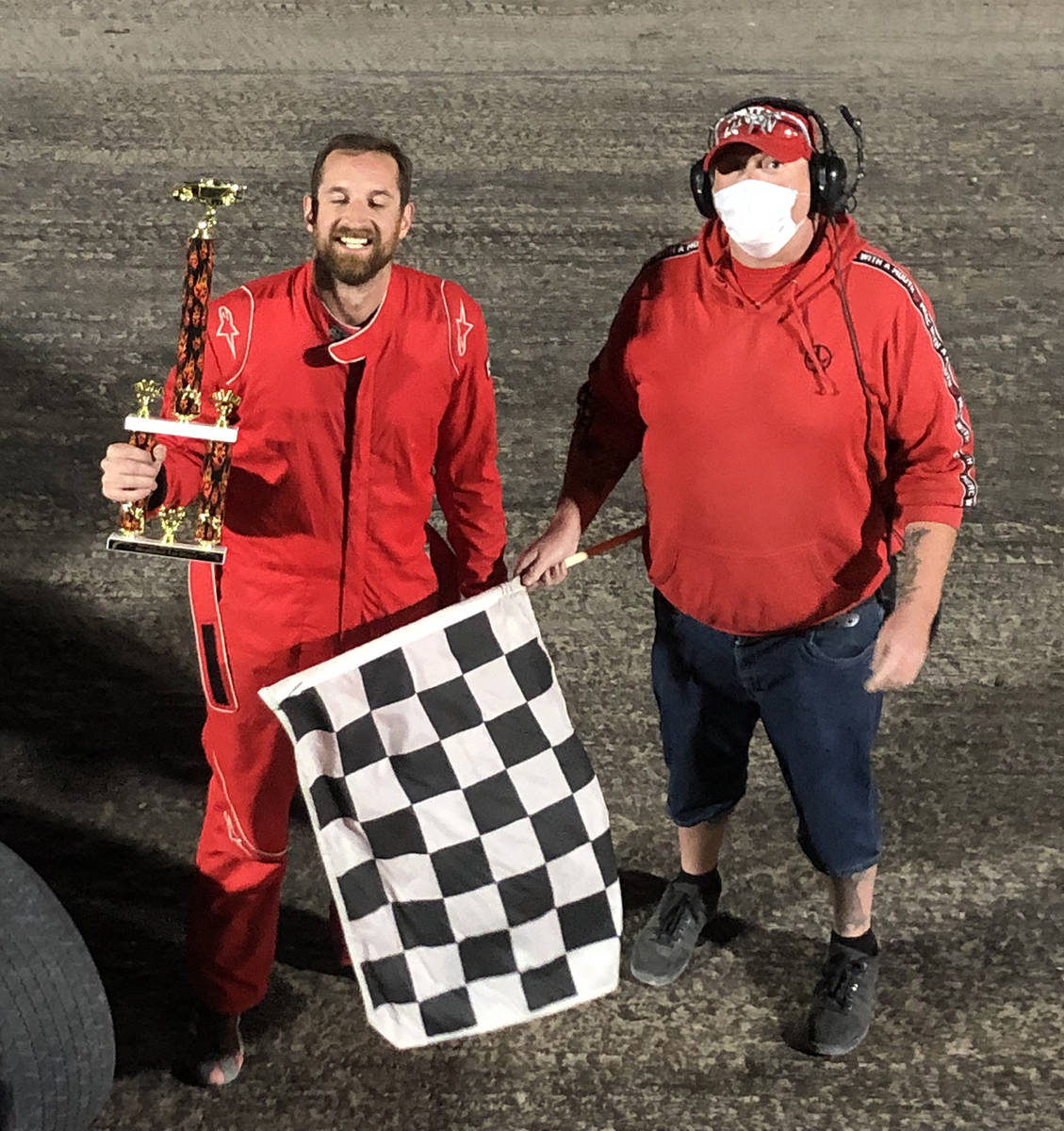 Tom Rysinski/Pahrump Valley Times Kyle Renberger, left, accepts the trophy from flagman Dale Ge ...
