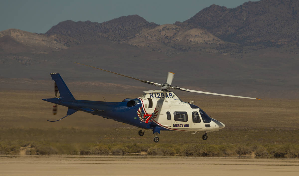 L.E. Baskow/Las Vegas Review-Journal A Mercy Air helicopter lifts off on its way to a rollover ...