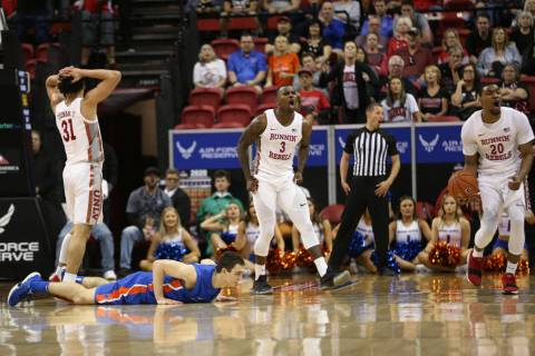 UNLV Rebels guard Marvin Coleman (31), guard Amauri Hardy (3) and forward Nick Blair (20) react ...
