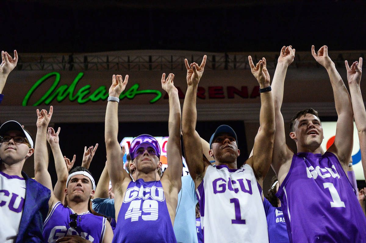 "Fans in the Grand Canyon University student section ""put their lopes up"" to cheer on ..."