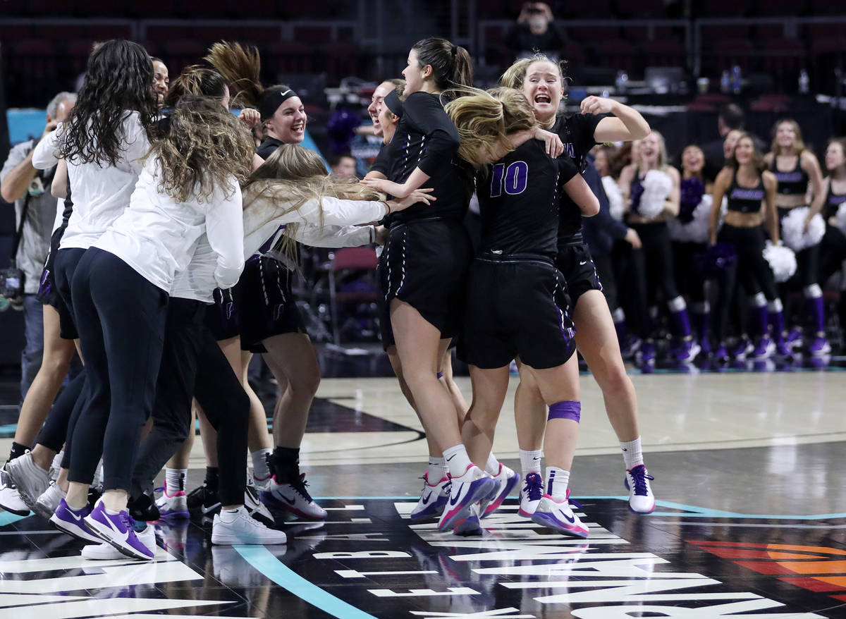 The Portland Pilots celebrate after winning the West Coast Conference championship against the ...