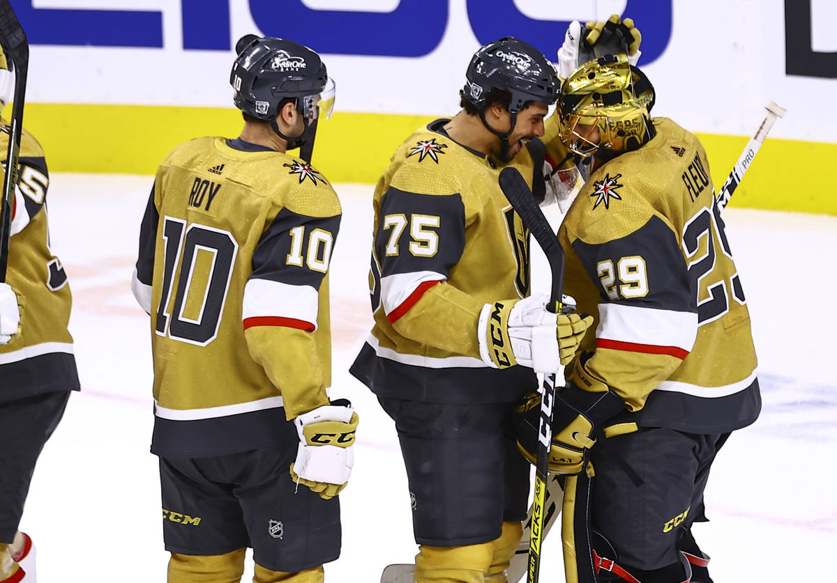 Golden Knights right wing Ryan Reaves (75) celebrates a 1-0 shutout win with goaltender Marc-An ...