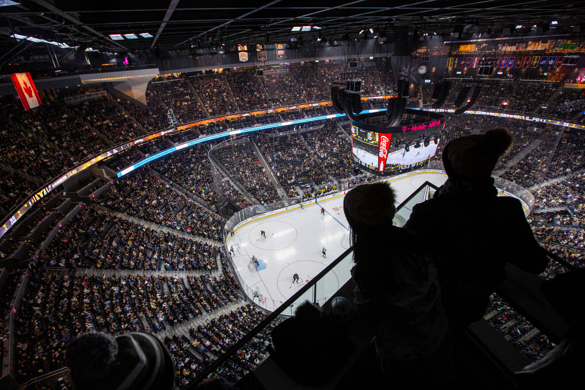 Golden Knights fans watch the action from the Hyde Lounge space at T-Mobile Arena during an NHL ...