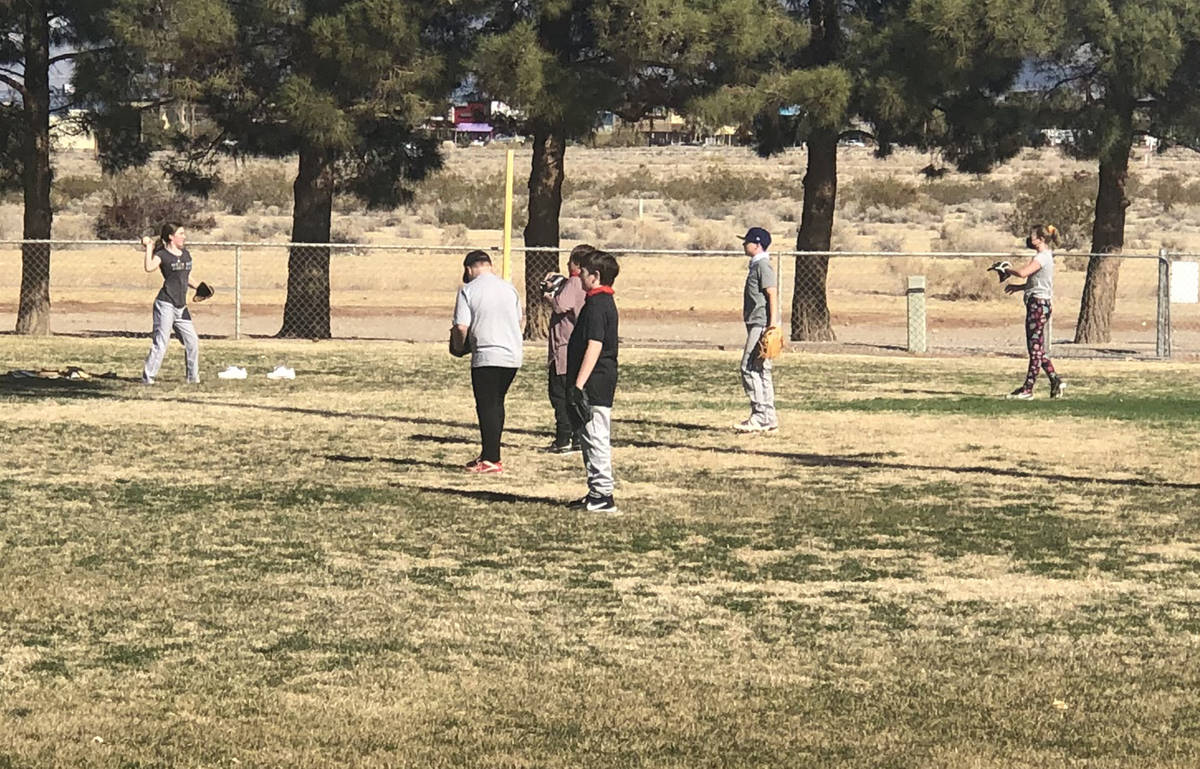 Tom Rysinski/Pahrump Valley Times Melanie Swingle, left, stands out among the boys warming up t ...