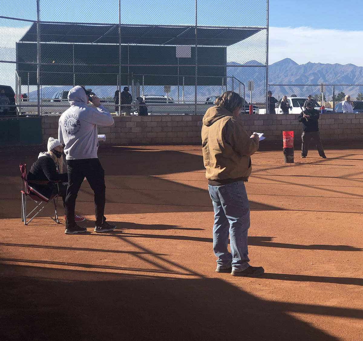 Tom Rysinski/Pahrump Valley Times Coaches watch as Richard Swingle hits ground balls during the ...
