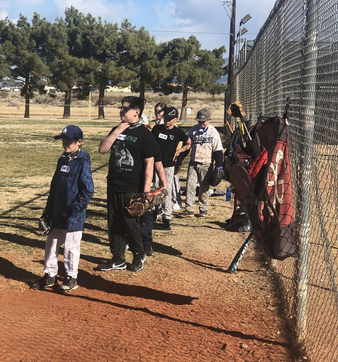 Tom Rysinski/Pahrump Valley Times Prospective baseball players line up for their turn at fieldi ...