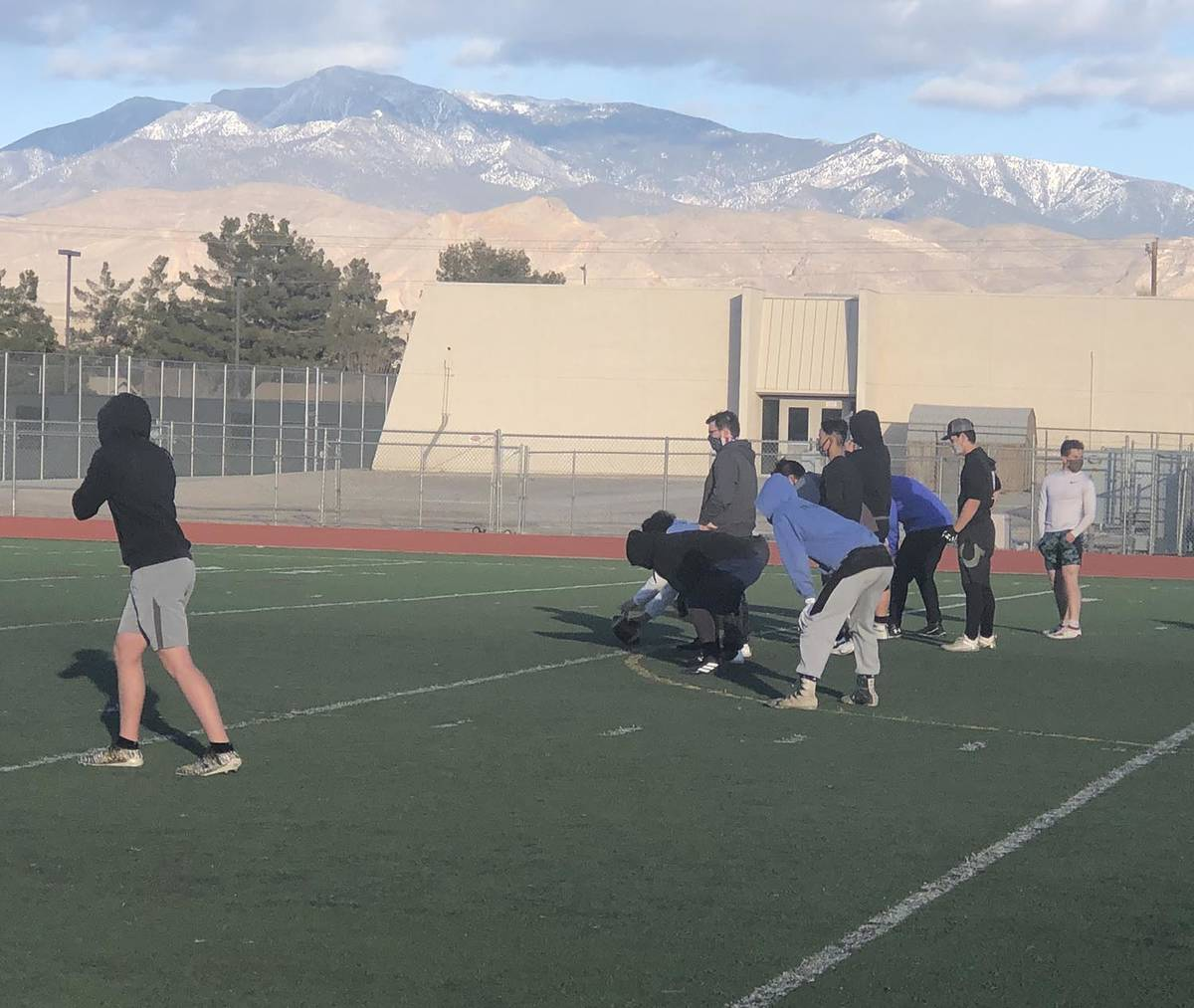 Tom Rysinski/Pahrump Valley Times Players line up to run a play during football practice Wednes ...