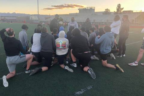 Tom Rysinski/Pahrump Valley Times Pahrump Valley High School football players listen to coach J ...