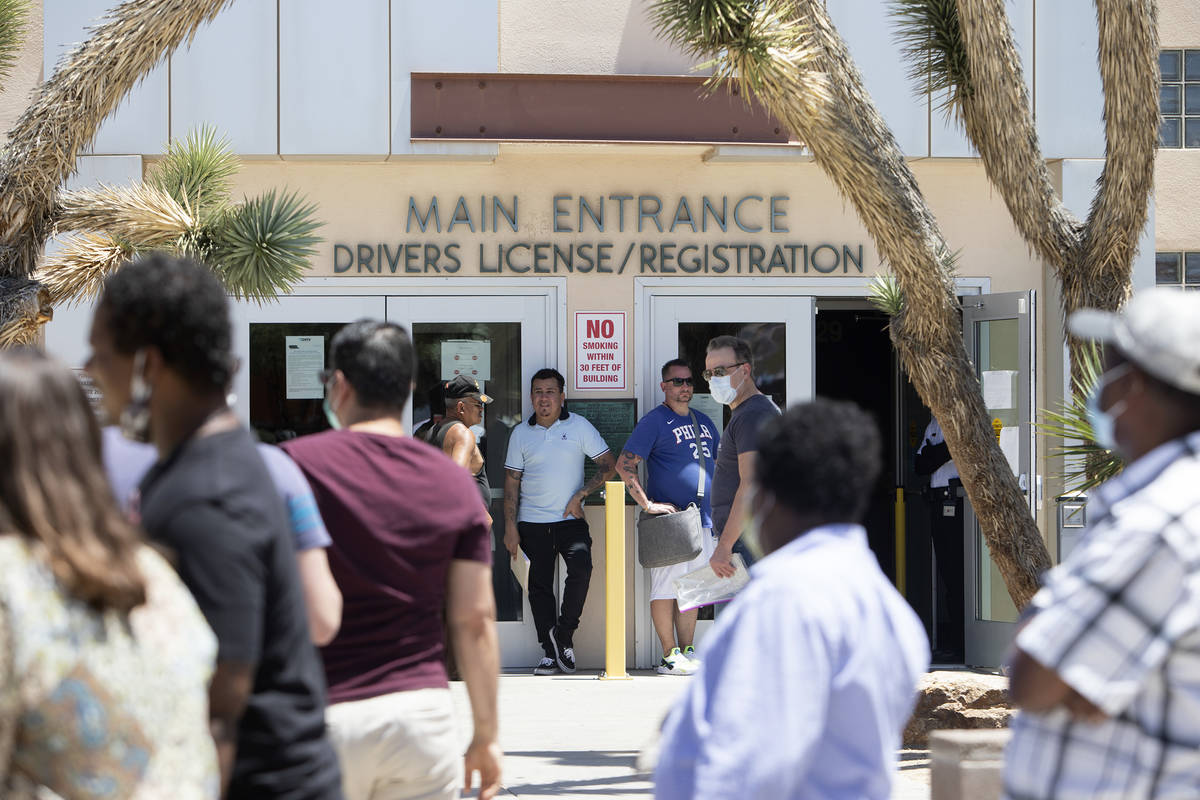 People wait in line at the Nevada Department of Motor Vehicles at 8250 W. Flamingo Road, on Mon ...