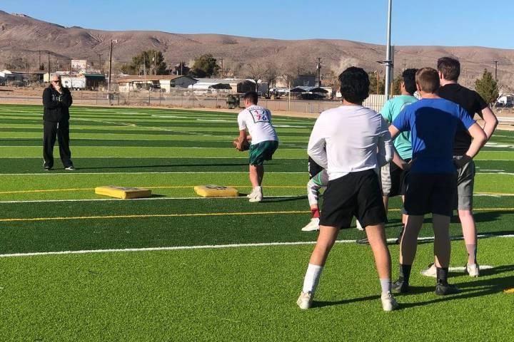 Tom Rysinski/Pahrump Valley Times Beatty High School football coach Leo Verzilli, left, watches ...