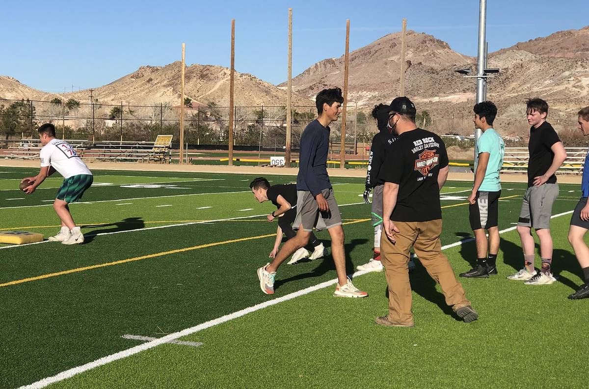 Tom Rysinski/Pahrump Valley Times Football players take turns running a drill as assistant coac ...