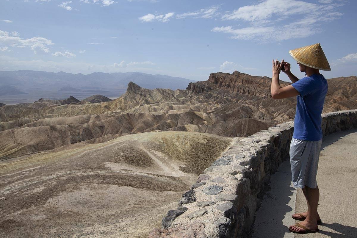 Ellen Schmidt/Las Vegas Review-Journal Peter Vukasin snaps a photo at Zabriskie Point in Death ...
