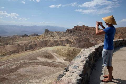 Peter Vukasin snaps a photo at Zabriskie Point in Death Valley National Park as temperatures re ...
