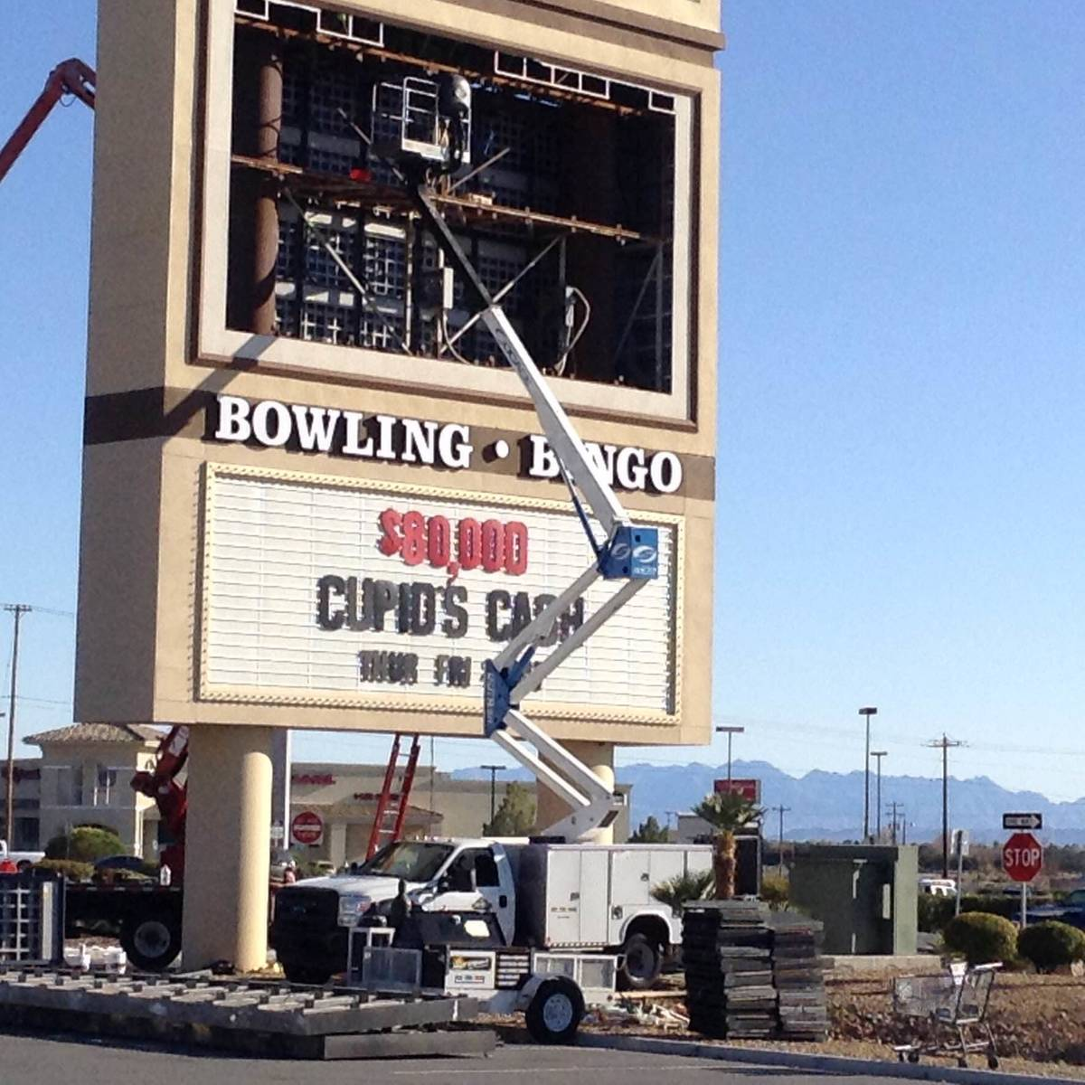 Workers put finishing touches to upgrades to the Pahrump Nugget Hotel and Casino sign off of Hi ...