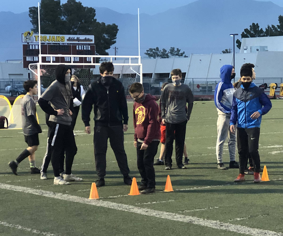 Tom Rysinski/Pahrump Valley Times Boys soccer players go through warmups at the start of practi ...