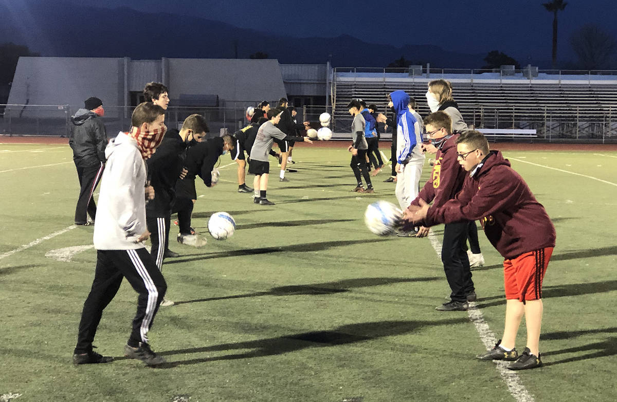 Tom Rysinski/Pahrump Valley Times Pahrump Valley High School boys soccer coach Chris Roberts, l ...
