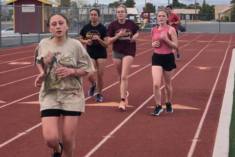 Tom Rysinski/Pahrump Valley High School Cross country athletes take laps around the track at Tr ...