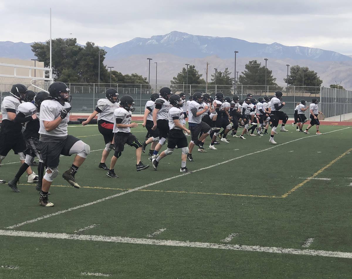Tom Rysinski/Pahrump Valley Times Pahrump Valley High School football players warm up before pr ...