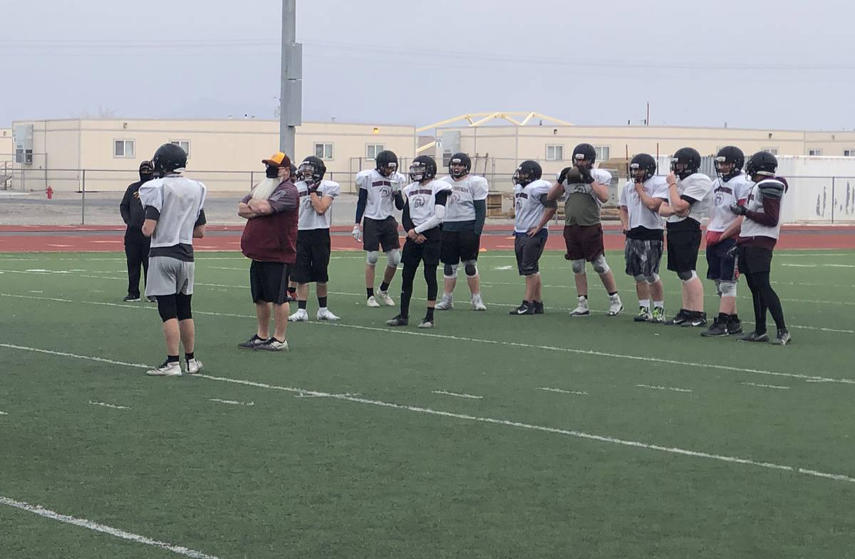 Tom Rysinski/Pahrump Valley Times Junior varsity coach Tom Walker directs players during a Marc ...
