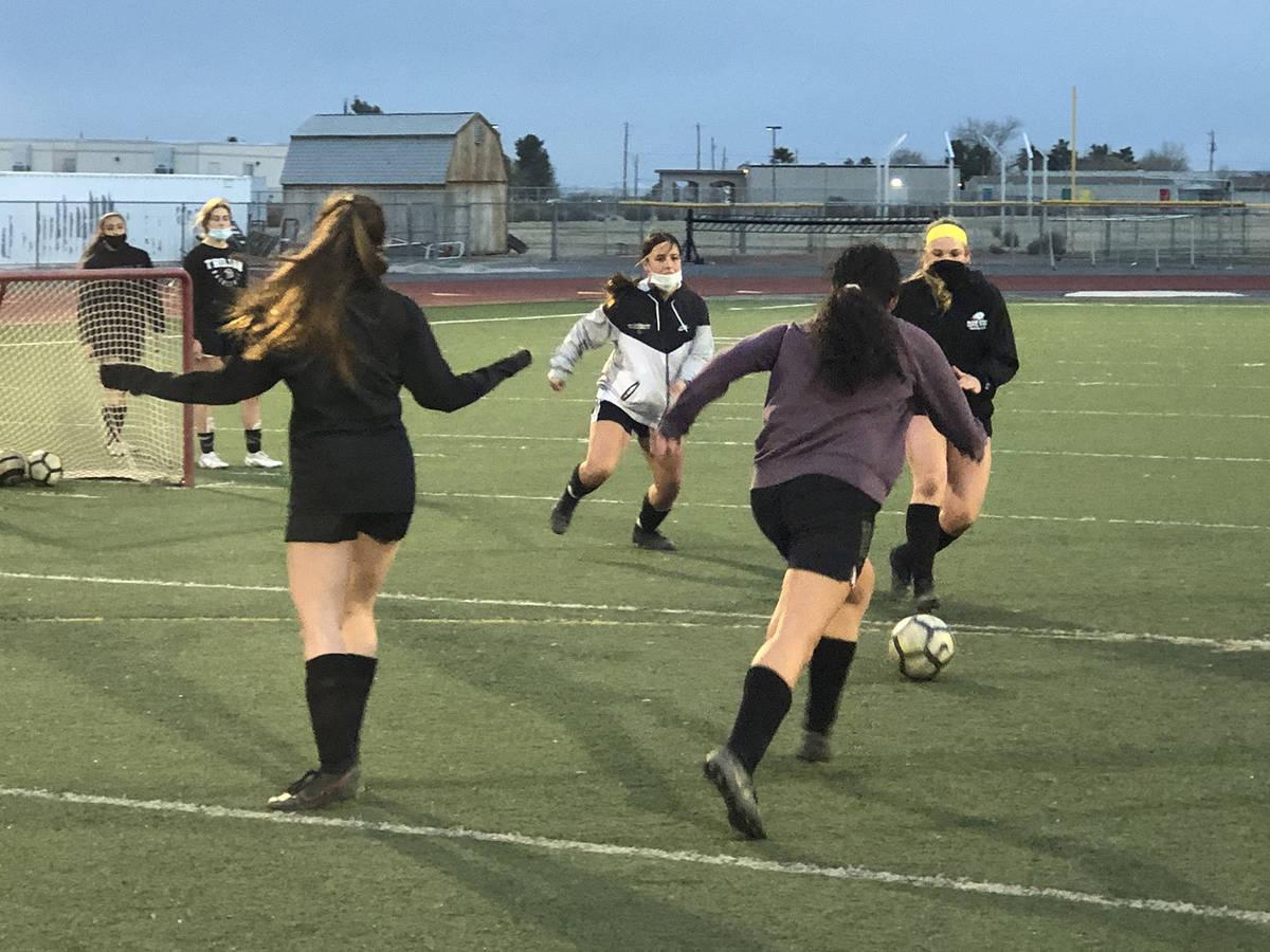 Tom Rysinski/Pahrump Valley High School Girls soccer players do a 2-on-2 drill during March 3 p ...