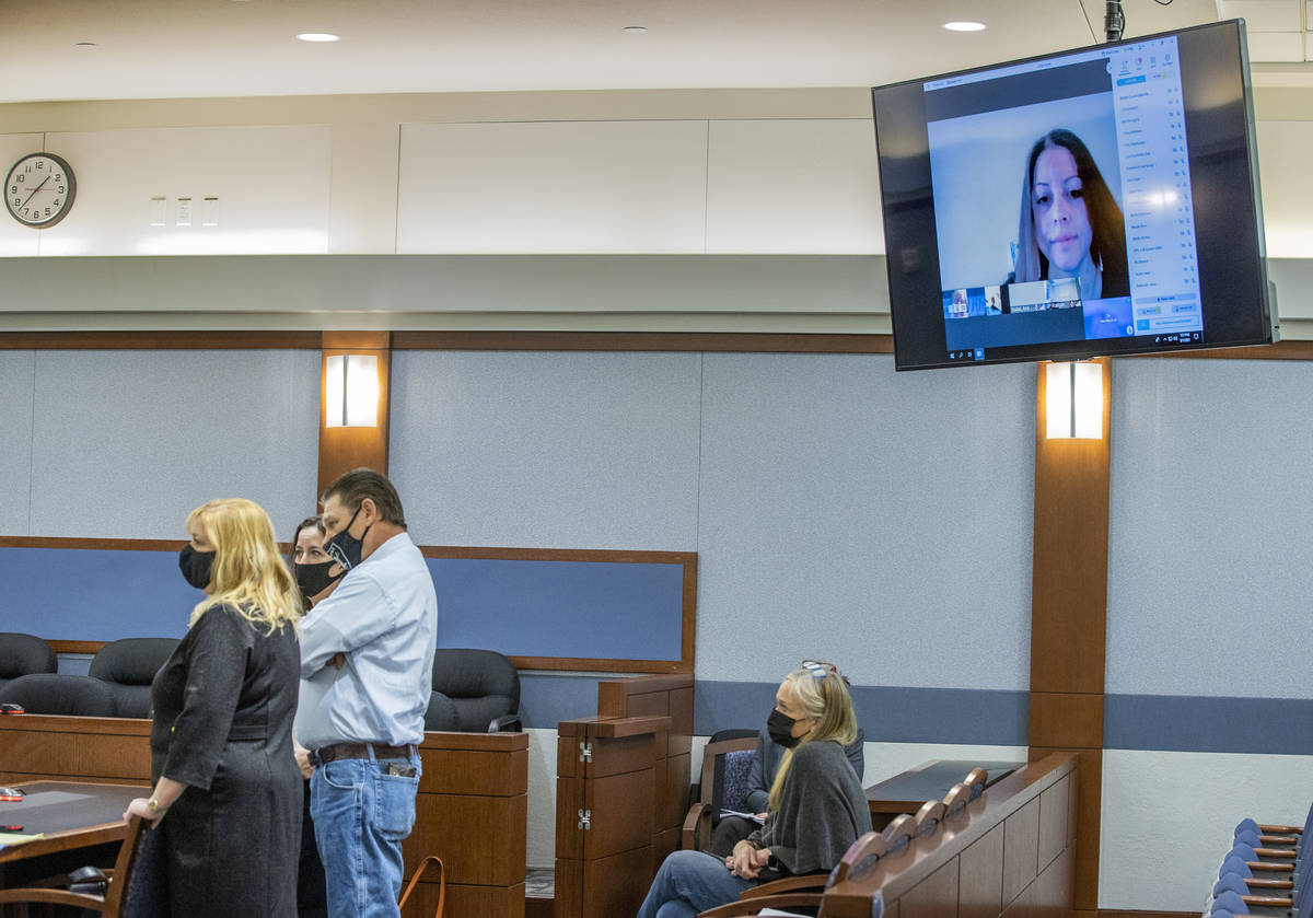 (From left) Attorney Lisa Rasmussen, attorney Kristina Wildeveld, Fred Steese and others listen ...