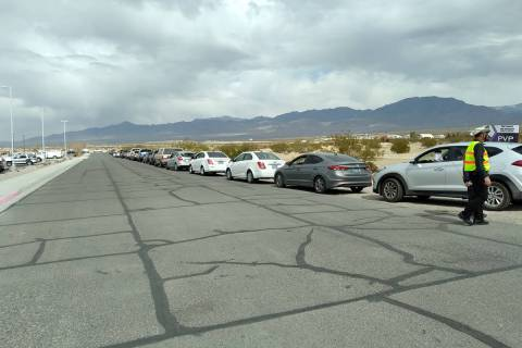 Selwyn Harris/Pahrump Valley Times Dozens of drivers and passengers lined up along Floyd Street ...