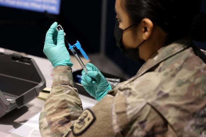 K.M. Cannon/Las Vegas Review-Journal Nevada National Guard Pfc. Kimberly Hernandez prepares Pfi ...