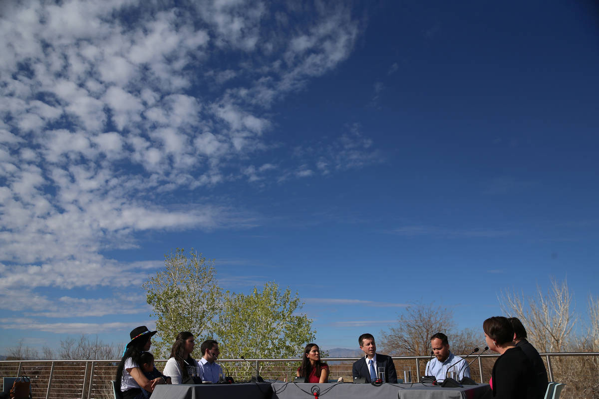 Democratic presidential candidate former South Bend, Ind., Mayor Pete Buttigieg, center, partic ...