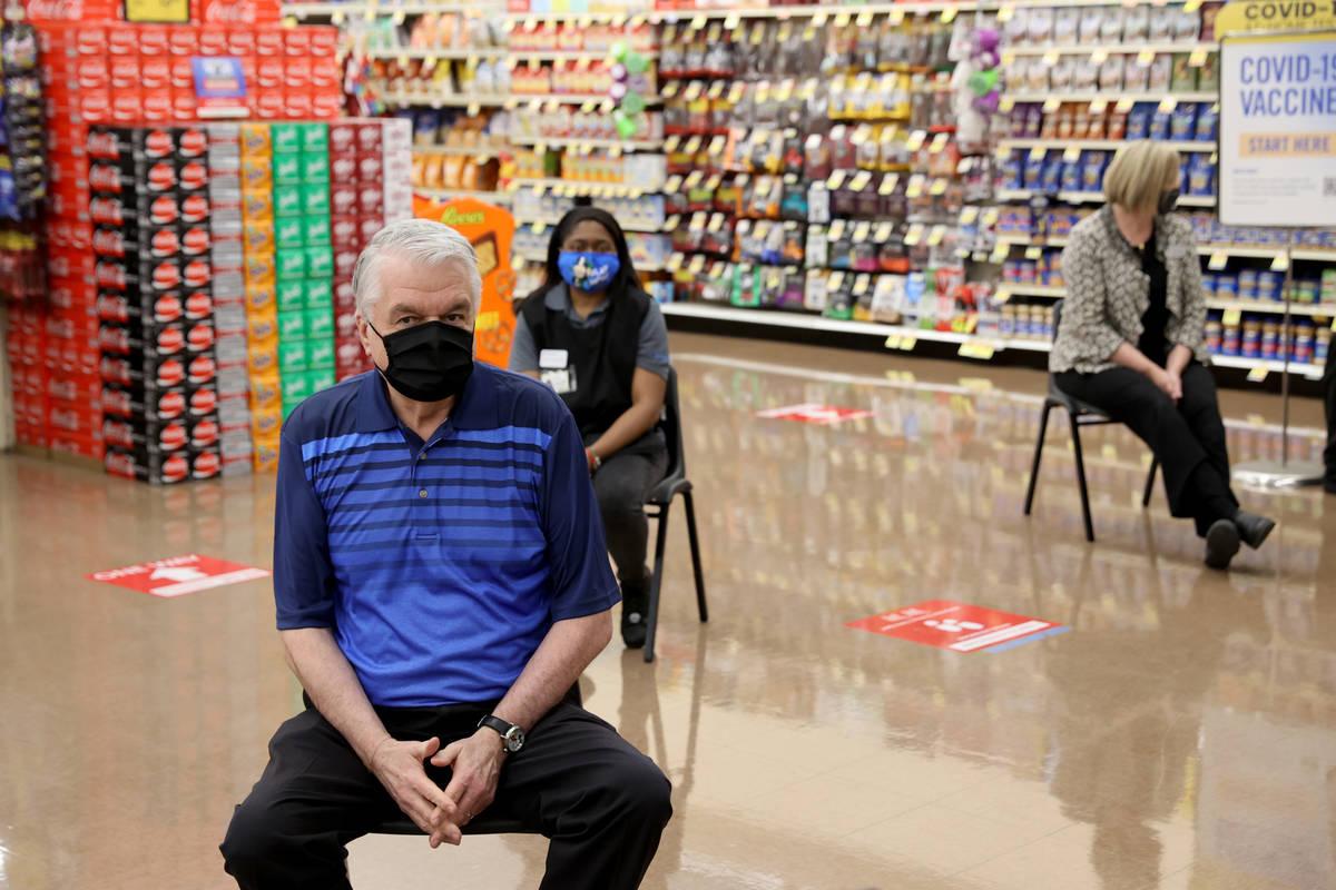 Gov. Steve Sisolak waits to receive his COVID-19 vaccine alongside frontline grocery store work ...