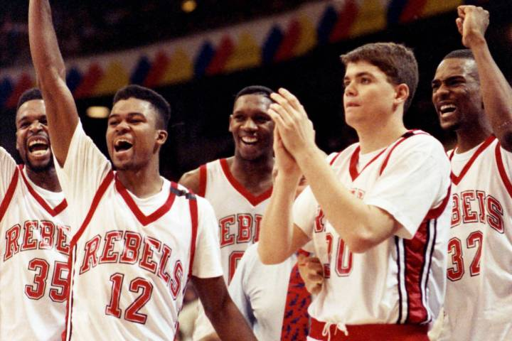 UNLV Rebels players Mosses Scurry, Anderson Hunt, David Butler, David Rice, Stacey Augmon surro ...