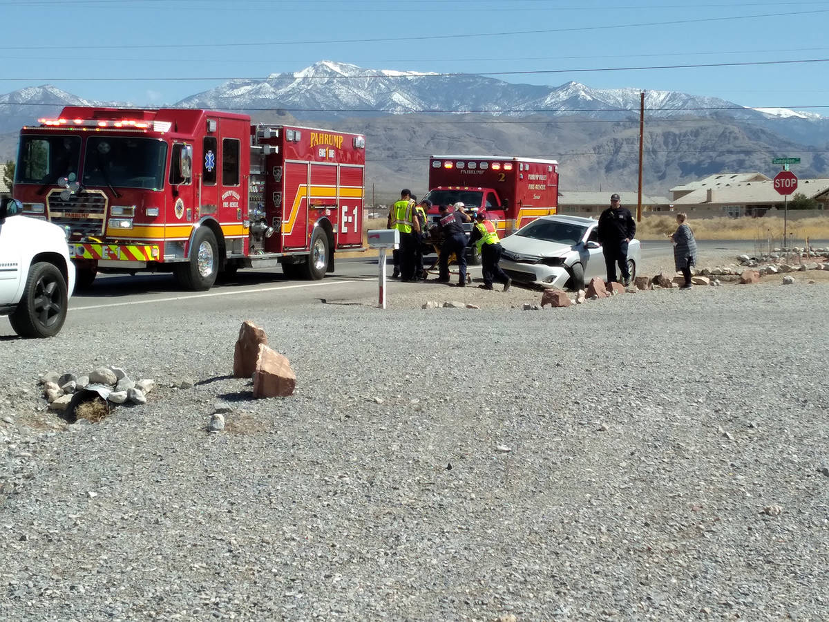 Selwyn Harris/Pahrump Valley Times Pahrump Valley Fire and Rescue Services EMTs prepare to tran ...