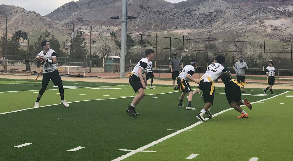 Tom Rysinski/Pahrump Valley Times Round Mountain freshman Gavin Banks drops back to pass during ...