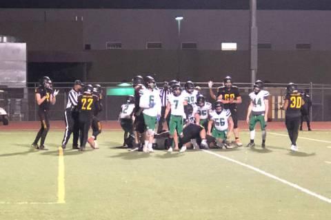 Tom Rysinski/Pahrump Valley Times Under the bodies is Pahrump Valley High School quarterback An ...