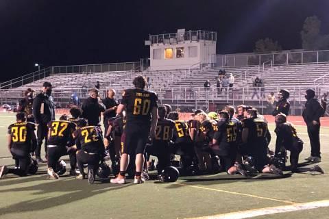 Tom Rysinski/Pahrump Valley Times Pahrump Valley High School football coaches talk to their tea ...