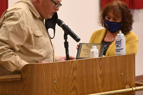 Richard Stephens/Special to the Pahrump Valley Times Randy Reed presents a plaque to Carrie Ra ...