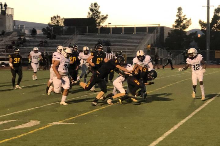 Tom Rysinski/Pahrump Valley Times Pahrump Valley junior Henry Amaya bulls his way for more yard ...