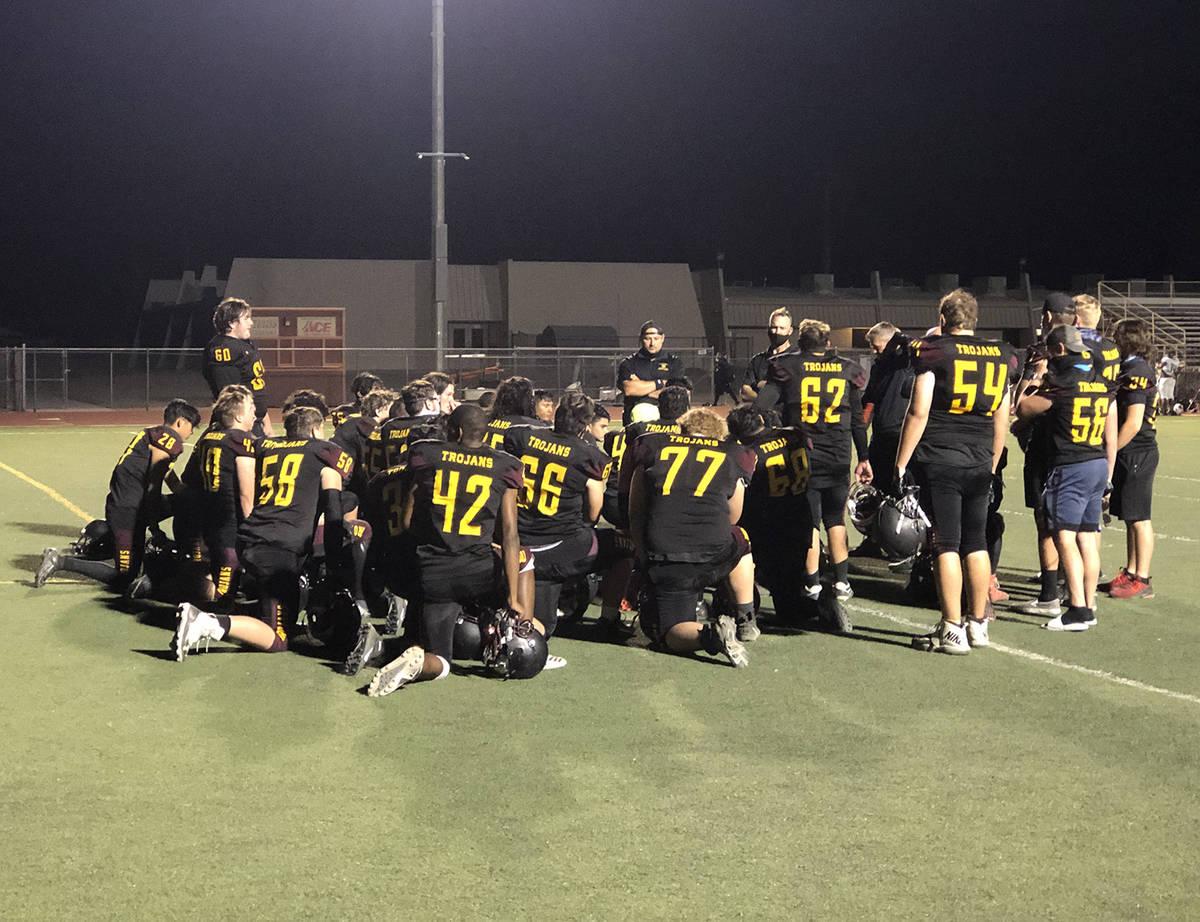 Tom Rysinski/Pahrump Valley Times Pahrump Valley High School football players listen to their c ...
