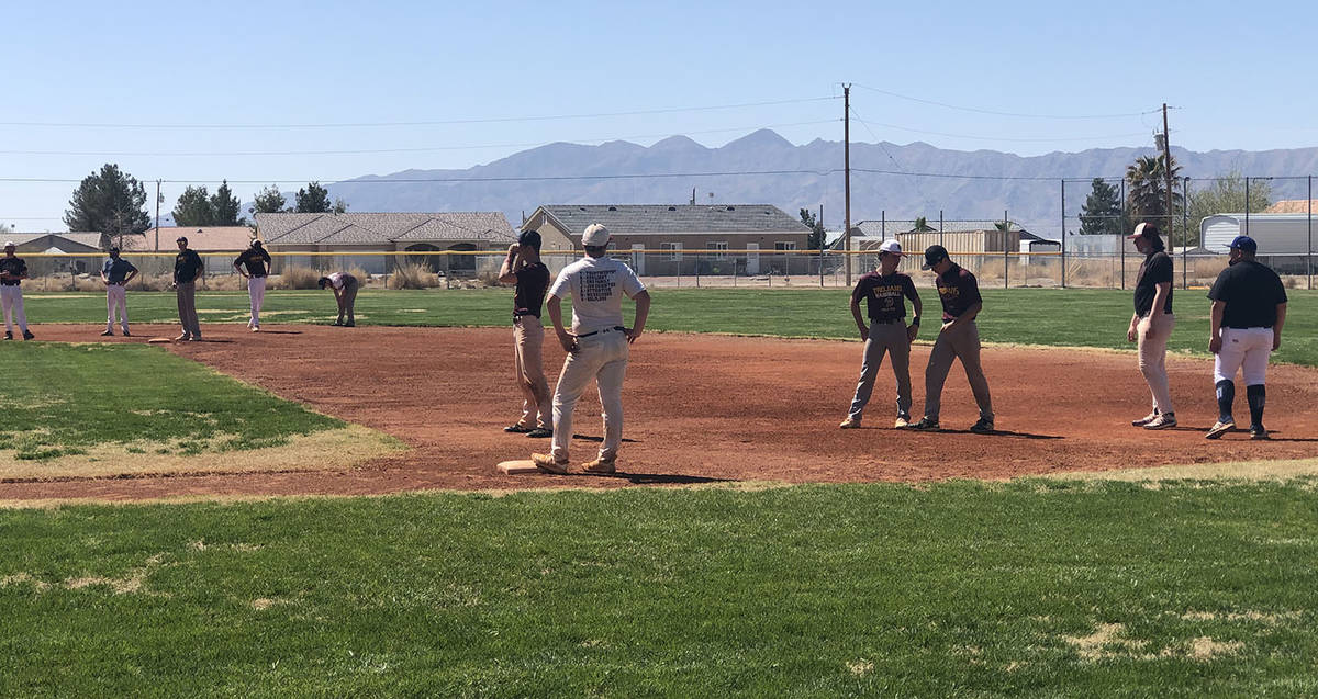 Tom Rysinski/Pahrump Valley Times Players were divided among the four bases for a running drill ...