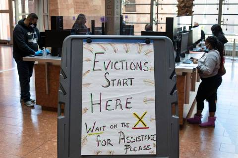 Tenants who received an eviction notice from their landlord, fill out forms at the Civil Law Se ...