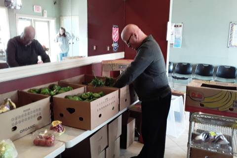 Selwyn Harris/Pahrump Valley Times Pahrump Salvation Army Pastor Jon Watt unloads various food ...