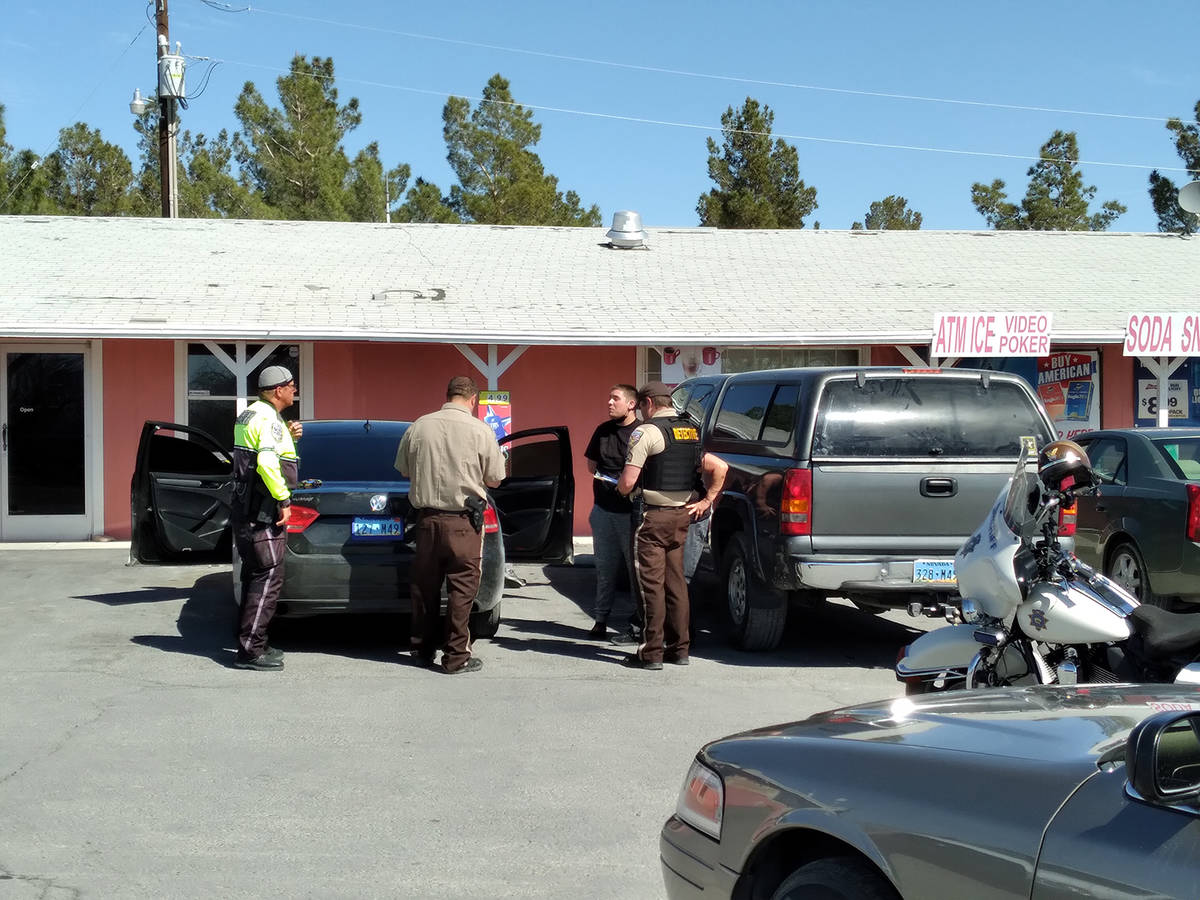 Selwyn Harris/Pahrump Valley Times Nye County Sheriff's Office deputies and detectives question ...