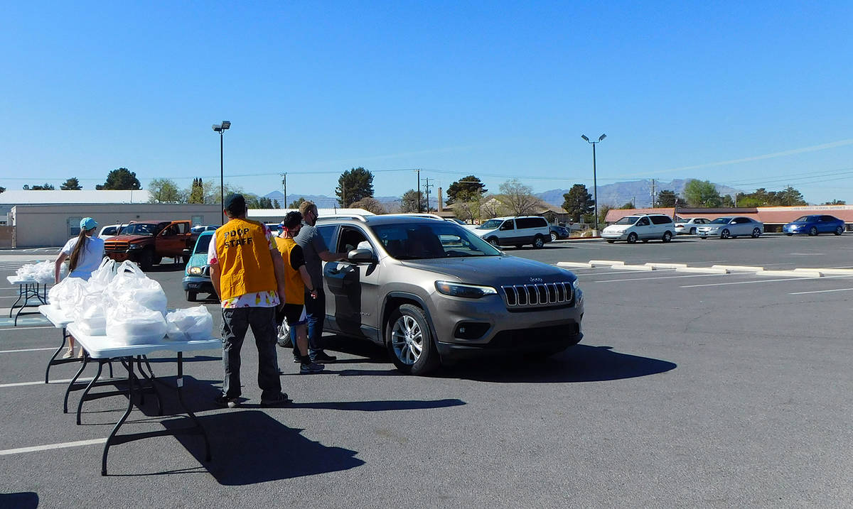 Robin Hebrock/Pahrump Valley Times A line of vehicles can be seen forming in the NyE Communitie ...