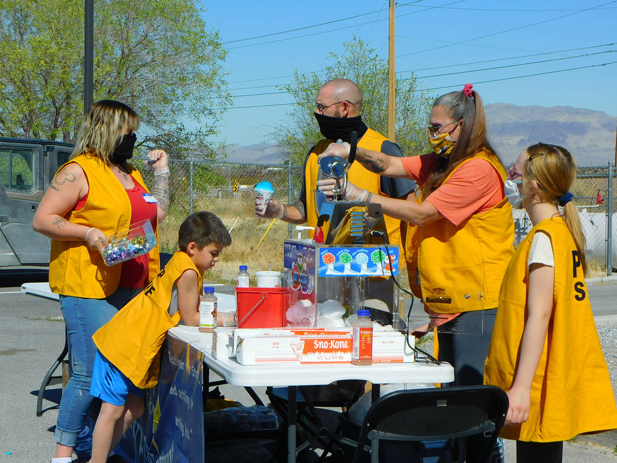 Robin Hebrock/Pahrump Valley Times Members of PDOP are pictured preparing snow cones, which wer ...