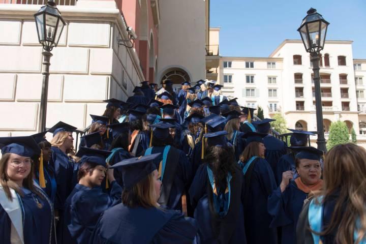 Jason Ogulnik/Las Vegas Review-Journal WGU Nevada graduates walk to their commencement ceremony ...