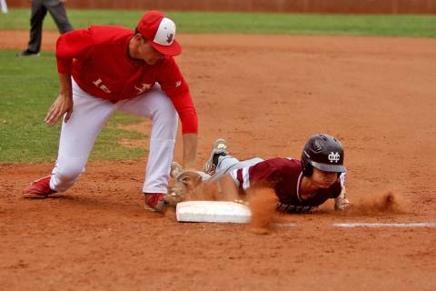 Arbor View's Jacob Scioli (16) attempts to tag out Cimarron-Memorial's Ethan Daniel (17) in th ...